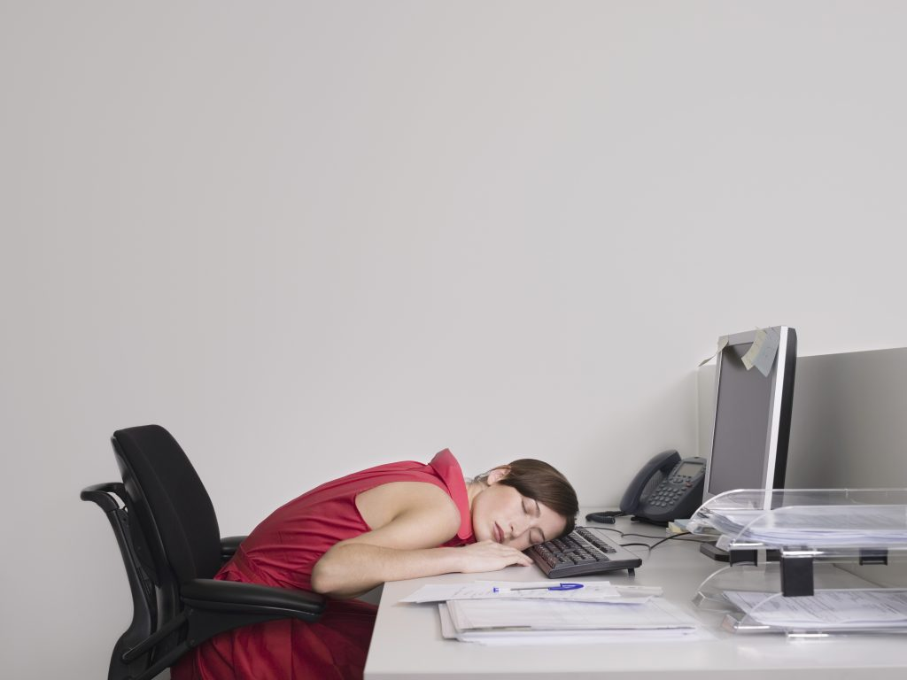 Office Worker Asleep at Desk